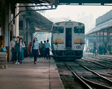 A train and busy platform at Yangon's central railway station, Myanmar